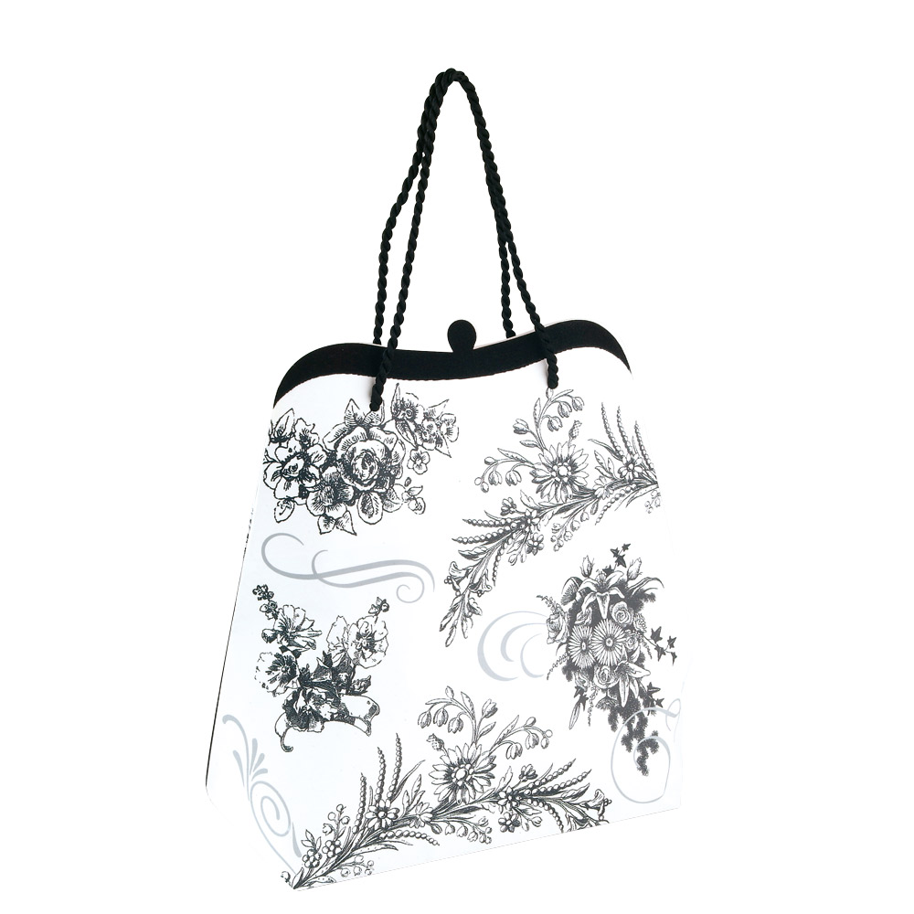 Black and white floral paper carrier bag with velcro fastening