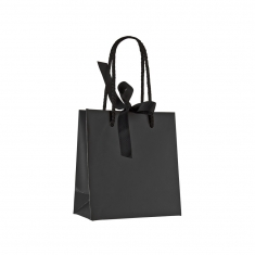 Black satin-finish paper boutique bag with black rope handles, ribbon fastener and interior