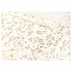 White gift wrapping paper printed with gold foliage motifs