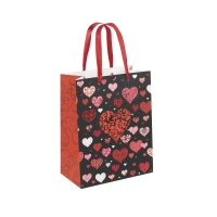 Paper carrier bag with hot-foil printed hearts on a black background, red gusset