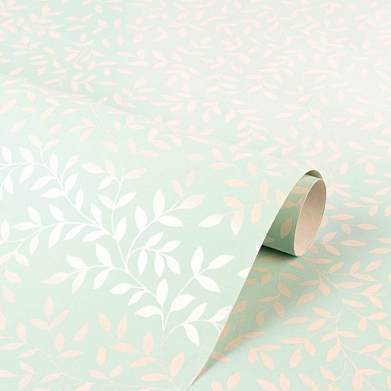 Pastel blue gift wrapping paper, matt background with white pearlescent foliage motifs