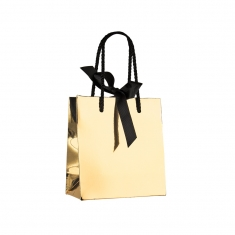 Gold mirror-effect paper boutique bag with black rope handles and ribbon fastener