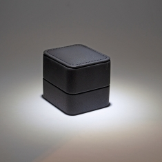 Imitation kidskin jewellery presentation boxes with top stitching and interior LED light