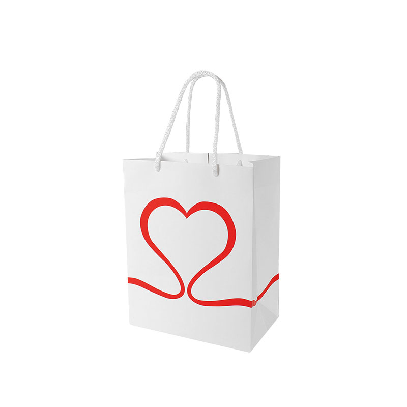 Matt white paper carrier bag with red heart shaped ribbon design
