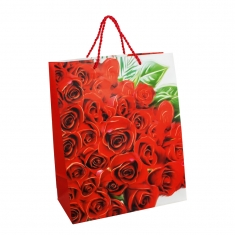 Paper carrier bag with red roses