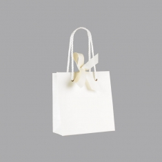Satin-finish white paper boutique bags with matching rope handles and ribbon fastener
