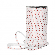 White curling ribbon printed with red hearts