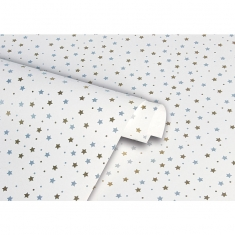 White gift wrapping paper covered in silver and gold stars
