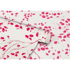 White gift wrapping paper with pink leaves and branch motifs